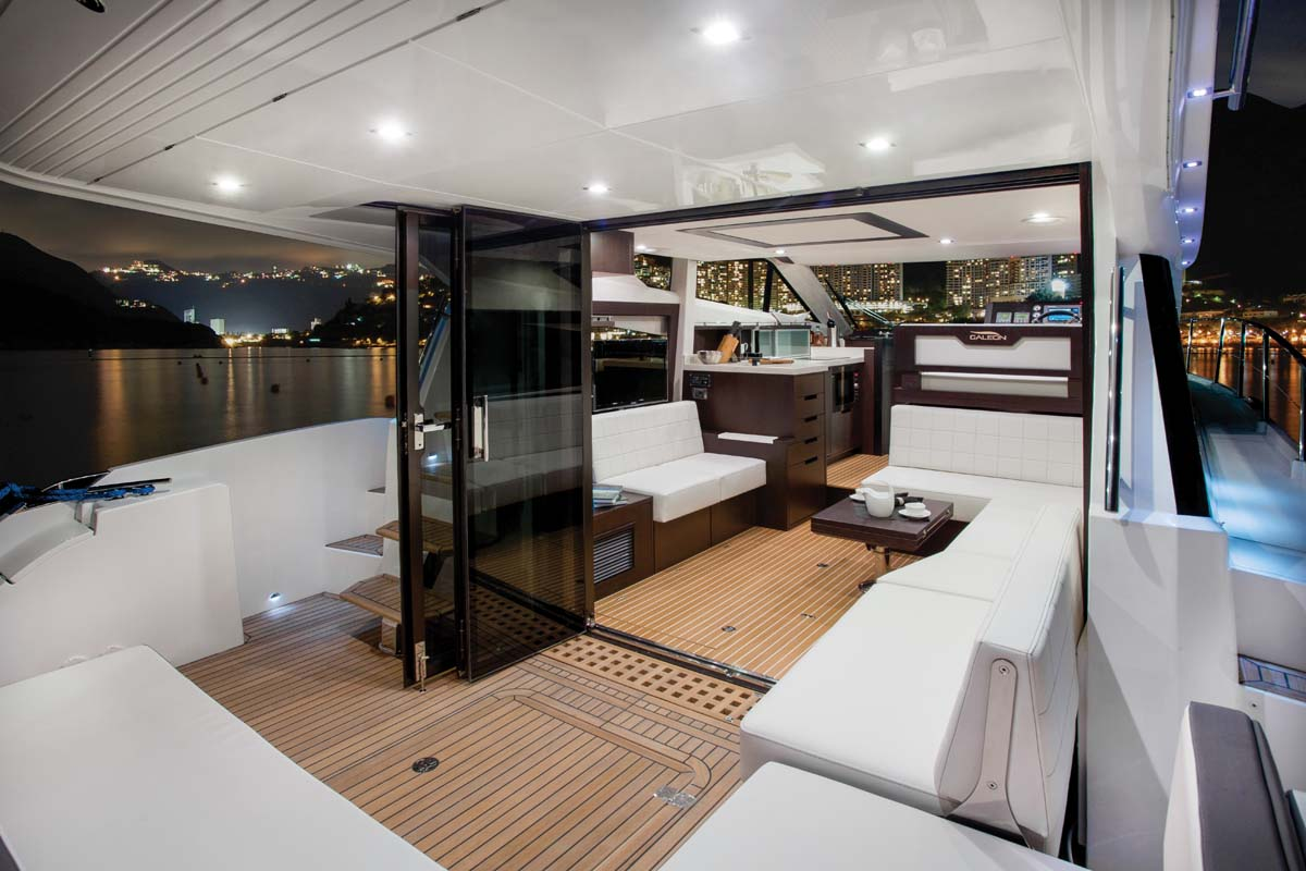 Thanks to a clever door arrangement, the main deck of the boat — including the helm and the galley, which are up one step from the salon — blends indoors and outdoors effortlessly.
